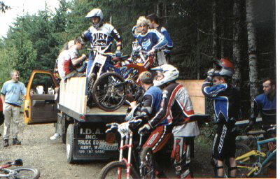 DH Racers load bikes into flatbed truck for another run